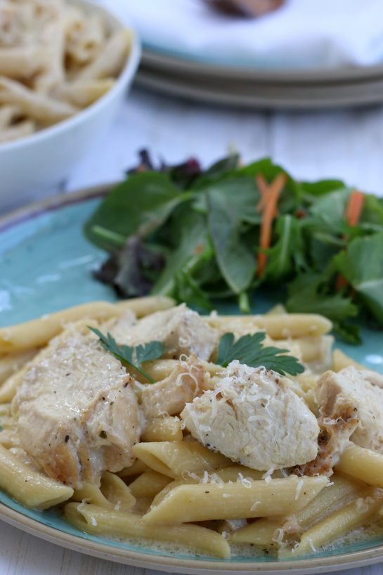 Chicken Alfredo served over penne pasta.