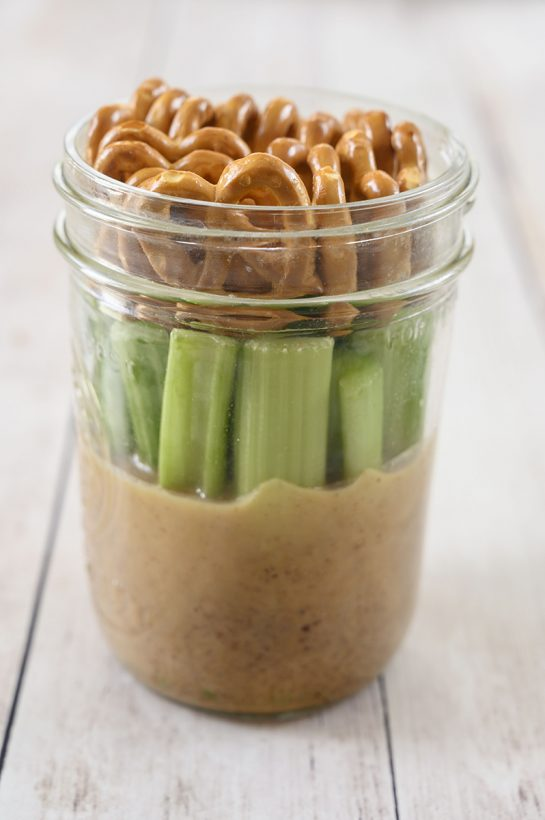 Gluten-free, vegan mason Jar Pretzel, Celery, Almond Butter Snack with SuperFat nut butter is the perfect healthy on-the-go snack loaded with protein to give you a quick boost of energy during the day!