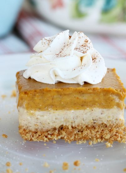 This amazing pumpkin cheesecake bars recipe has buttery graham cracker crust, a cream cheese layer and a pumpkin cream cheese layer! A great fall dessert idea!