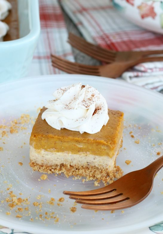 This amazing pumpkin cheesecake bars recipe has buttery graham cracker crust, a cream cheese layer and a pumpkin cream cheese layer! A great, easy fall dessert idea!
