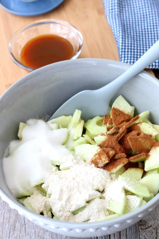 Here we see the caramel apple pie recipe starting out, the seasongings and sugar being added to the apples.