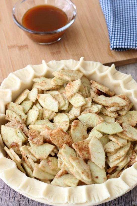 Next the caramel apple pie filling goes into a prepared dish with crust before it is baked.