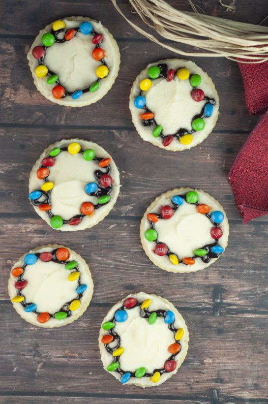 Christmas Light Bulb Cookies recipe are a fun treat to make with your kids for the holidays! These will become a holiday favorite and are almost too pretty to eat.
