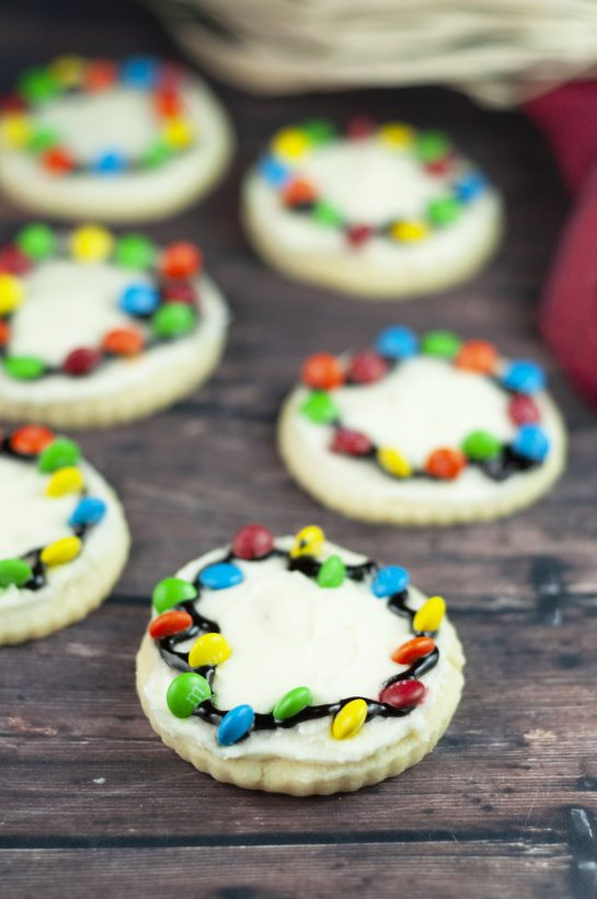 You don't need royal icing to make these Christmas Light Bulb Cookies recipe. They are a fun treat to make with your kids for the holidays! These will become a holiday tradition and are almost too pretty to eat.