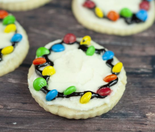 You don't need royal icing to make these Christmas Light Bulb Cookies recipe. They are a fun treat to make with your kids for the holidays! These will become a holiday favorite and are almost too pretty to eat.