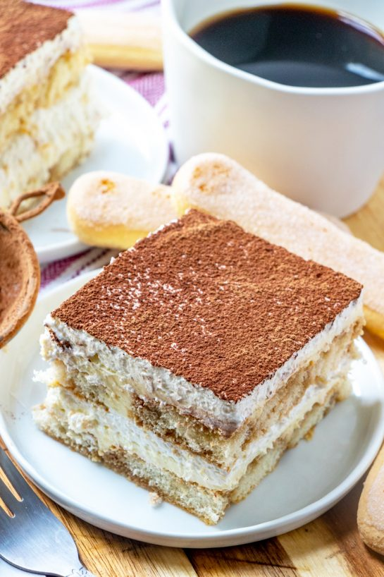 Traditional Grandma's Tiramisu is an authentic classic coffee-flavored Italian dessert idea for the Thanksgiving, Easter and Christmas. This is one of my favorite desserts and is actually pretty simple to bake!