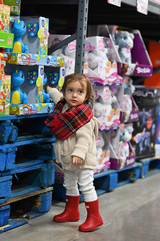 Toddler girl shopping for toys at BJ's Wholesale Club