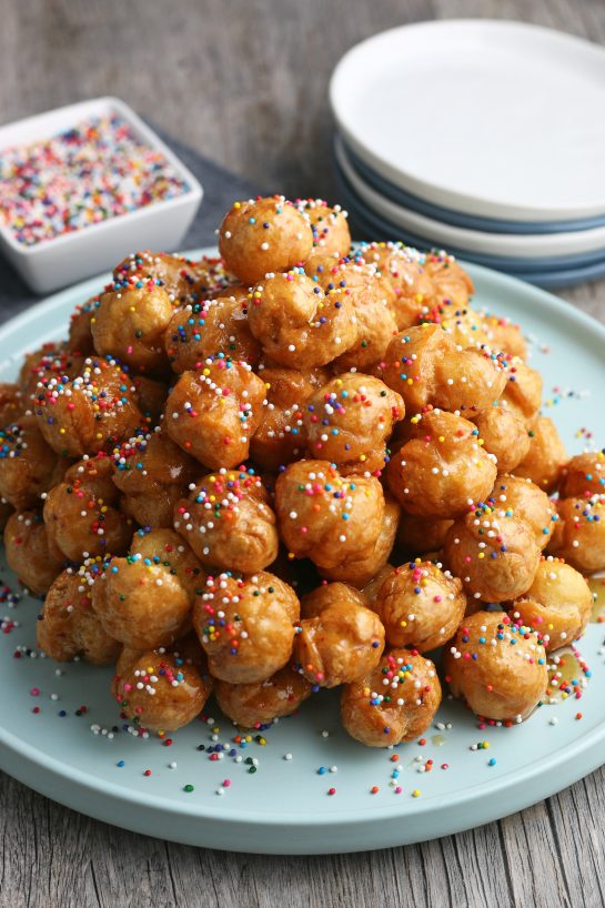 A view of the finished Italian honey balls piled up and decorated ready to be enjoyed.