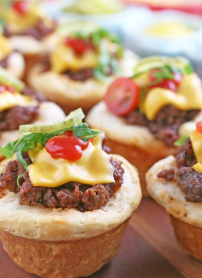 Here we see the finished cheeseburger biscuit bites finished and topped with veggies to eat!