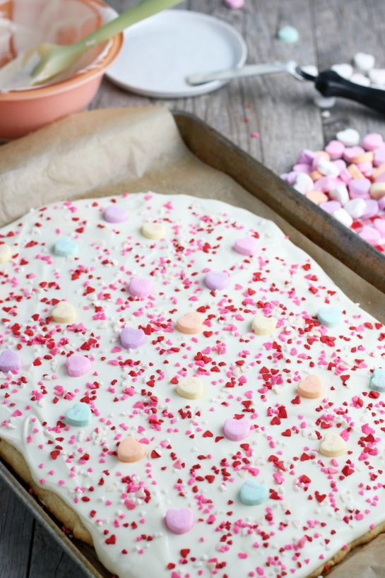 Now we add the conversation hearts to the cookie bark to finish it off.