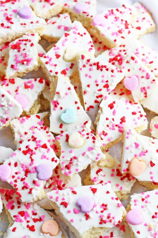 A close up look at the conversation heart cookies broken into chunks and ready to be eaten.
