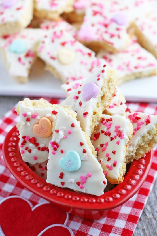 A bowl full of the conversation hearts cookie bark ready to be shared and enjoyed.