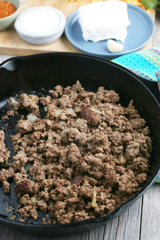 The first step in our taco pasta recipe is to fry up our meat and onions!