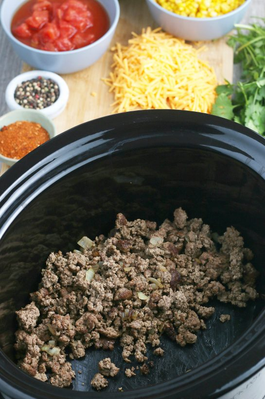 Now the cooked meat goes into our slow cooker taco pasta recipe!