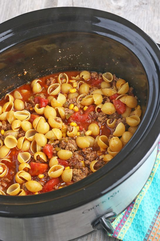 This image shows the pasta added to our slow cooker taco pasta and mixed up.