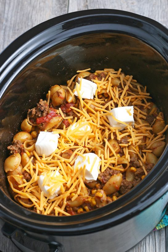 Cheese goes on top at the very end to make our Mexican pasta in the slow cooker cheesy and delicious!