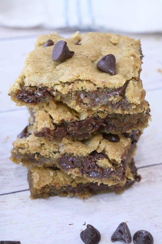 Easy Chewy Chocolate Chip Cookie Bars is a dessert recipe made without a mixer or chilling the dough! Everyone asks for the recipe!