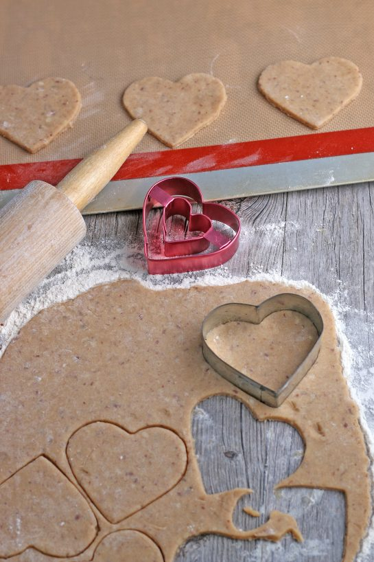 This image shows the heart shaped cookies being cut out and placed on our baking sheets.