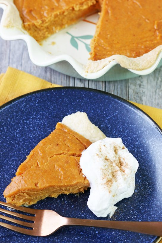 A top down view of the slice of the finished sweet potato pie recipe with whipped cream!