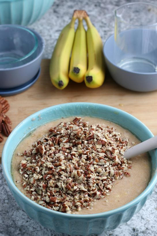 Adding the pecans for the Homemade Hummingbird Cake recipe