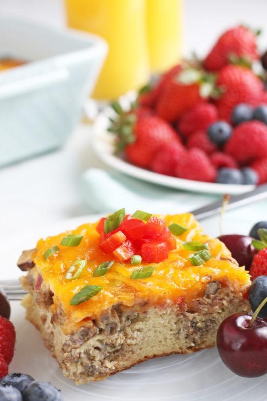 A close up shot shows us the side of this breakfast casserole egg and sausage recipe with all the delicious layers on display.