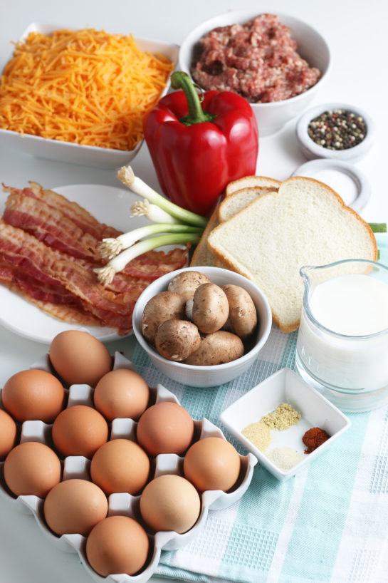 All of the ingredients needed to make a breakfast casserole egg and sausage recipe laid out before we begin.