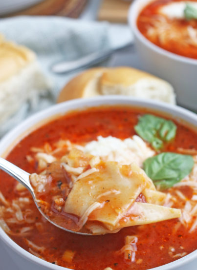 A spoonful of the delicious lasagna soup ready to be enjoyed.