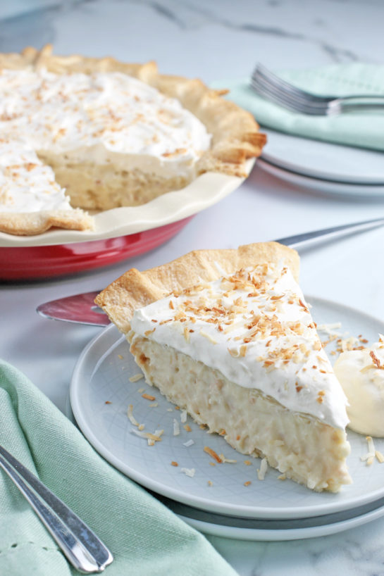 This photo shows us a slice of the best coconut cream pie recipe all finished and ready to eat.