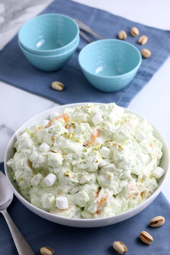 This shot shows the watergate salad in a bowl with smaller serving bowls ready and waiting to be filled.