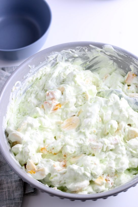 Everything needs a good stir to combine all the delicious ingredients in the pistachio fluff salad.