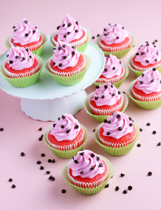 Photo of the decorated watermelon cupcakes with buttercream frosting and mini chocolate chips on top