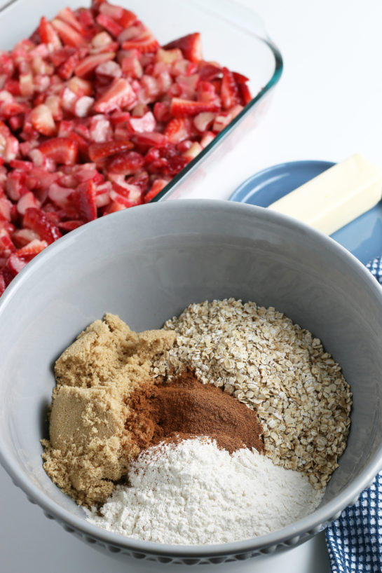 Mixing the dry ingredients for Strawberry & Rhubarb crisp recipe