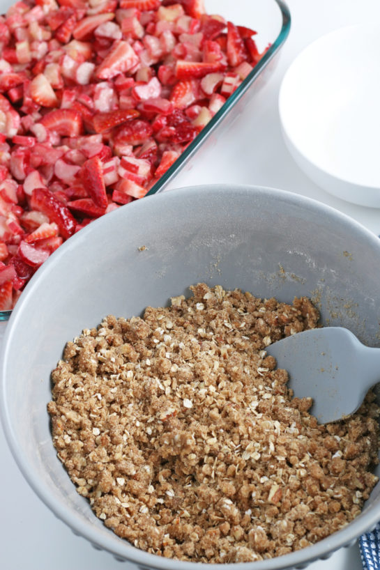 Mixing the crumble topping for Strawberry & Rhubarb crisp dessert recipe