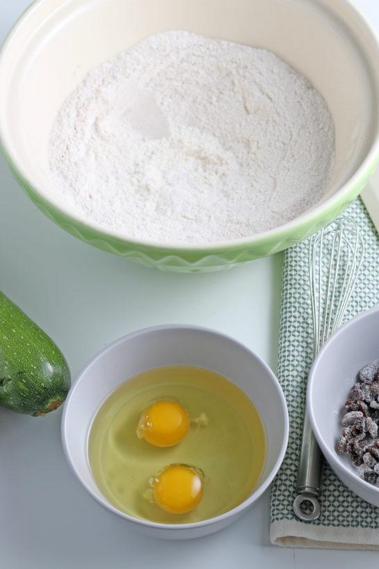 Adding the eggs to make the zucchini muffins recipe