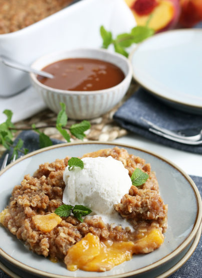 The Best Fresh Peach Crisp recipe: deliciously sweet and juicy peach layer topped with the most irresistible crisp topping in the world. This is the perfect summer and fall dessert and is super easy to make!