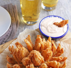 Fried Blooming Onion with a homemade dipping sauce is the ultimate appetizer recipe. Grab a sweet onion and turn it into a, incredible delicious snack!