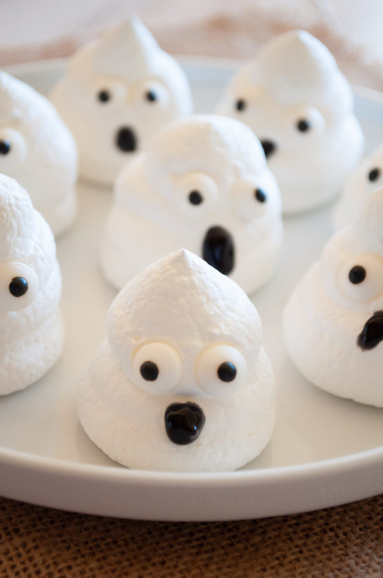 Easy Halloween Boo Meringues are an incredibly fun and easy Halloween recipe for kids for a party! The whole family will love them!