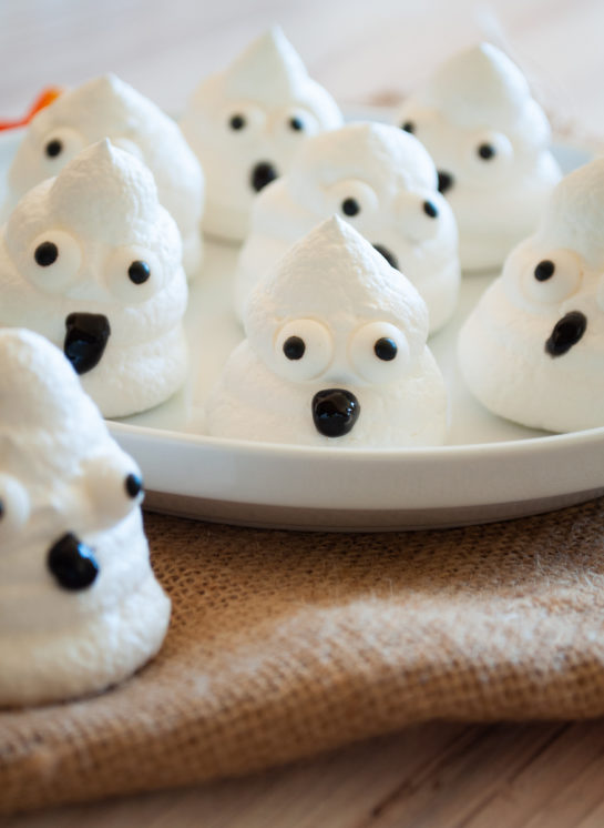 Simple Halloween Boo Meringues are an incredibly fun and easy Halloween recipe for kids for a holiday party! The whole family will love eating them!