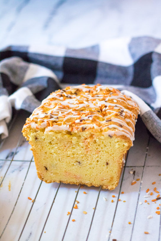 Fall Confetti Sweet Bread recipeis super moist and flavorful. This breakfast or dessert bread is easy to make and doesn't require a mixer - just a bowl, spatula and bread loaf pan. This is perfect for Thanksgiving or Halloween!