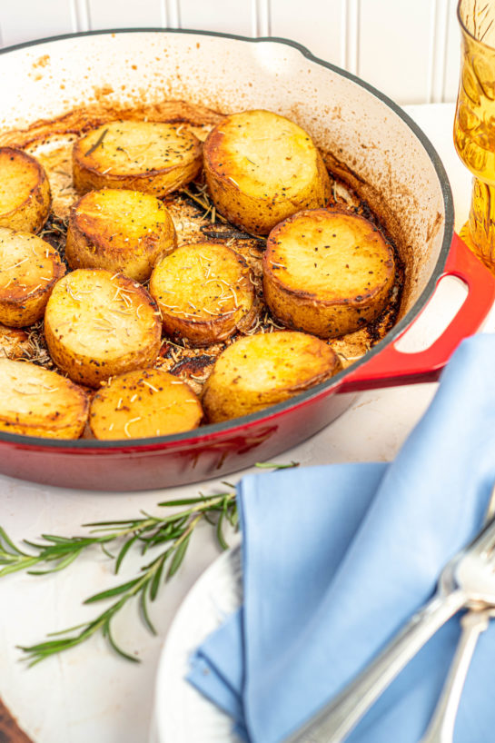 Holiday Melting Potatoes recipe might just become your new go-to side dish for Thanksgiving and Christmas! Baking the Russet potatoes in high heat caramelizes the outsides, and finishing them in chicken stock makes the insides creamy!