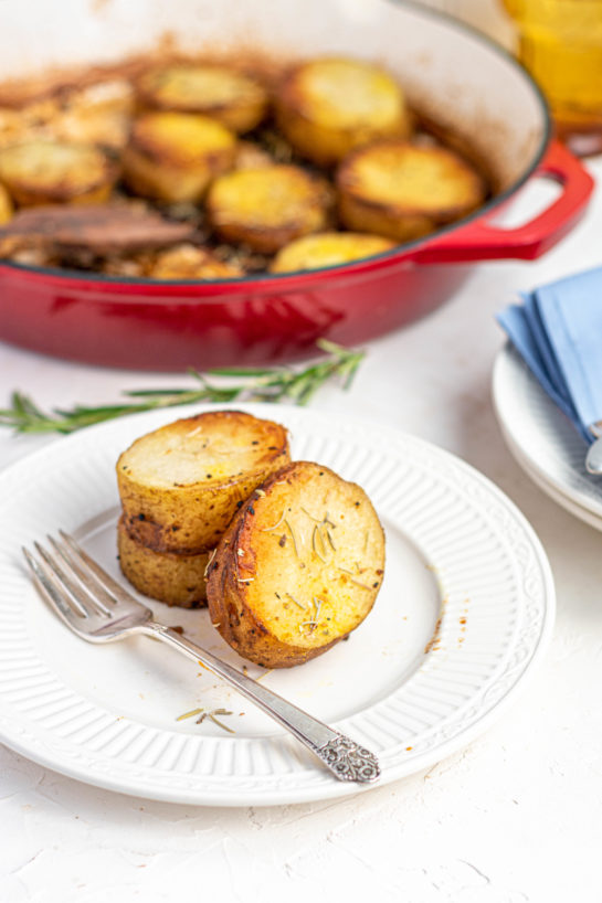 Very simple Melting Potatoes recipe might just become your new go-to side dish for Thanksgiving and Christmas! Baking the Russet potatoes in high heat caramelizes the outsides, and finishing them in chicken broth makes the insides creamy!