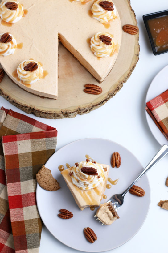 Overhead shot of the No Bake Pumpkin Cheesecake with extra spiced flavor and gingersnap crust. It is a fool proof recipe because it turns out amazing every time! This is the perfect holiday dessert!