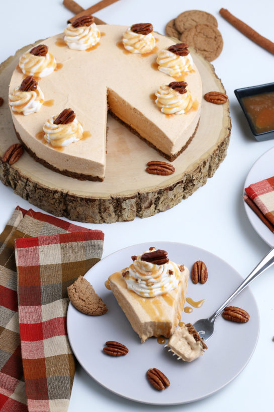 Smooth and creamy No Bake Pumpkin Cheesecake with extra spiced flavor and gingersnap crust. It is a fool proof recipe because it turns out amazing every time! What a perfect Thanksgiving or Christmas dessert!