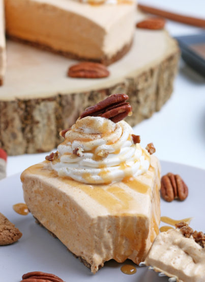 Close-up shot of the No Bake Pumpkin Cheesecakewith extra spiced flavor and gingersnap crust.It is a fool proof recipe because it turns out amazing every time! This is the perfect holiday dessert!
