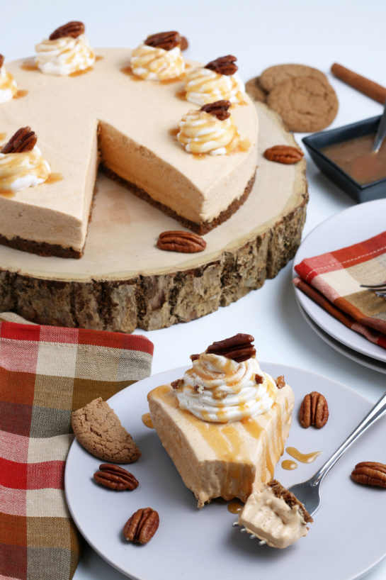 Smooth and creamy No Bake Pumpkin Cheesecake with extra spiced flavor and gingersnap crust. It is a fool proof recipe because it turns out amazing every time! This is the perfect Thanksgiving or Christmas dessert!