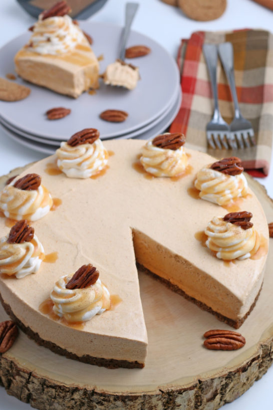 Smooth and creamy No Bake Pumpkin Cheesecake with extra spiced flavor and gingersnap crust. It is a fool proof recipe because it turns out amazing every time! What a perfect Thanksgiving dessert!