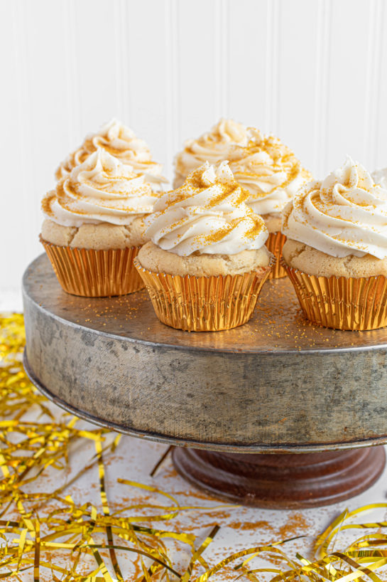 Celebration Champagne Cupcakes recipe is perfect for birthdays, Mother's Day brunch or a New Year's Eve dessert! They are jazzed up with gold sprinkles to add some glam!