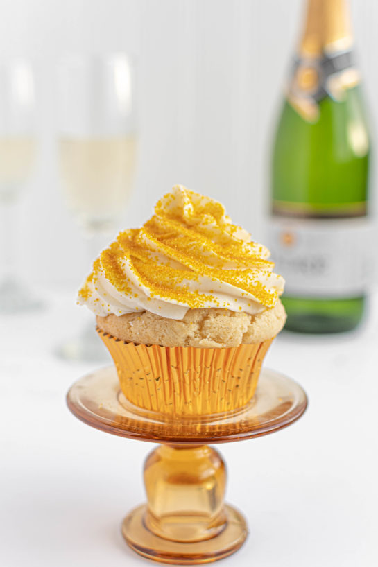 New Year's Eve Champagne Cupcakes recipe is perfect for birthdays, Mother's Day brunch or a New Year's Eve dessert! They are jazzed up with gold sprinkles to add some glam!