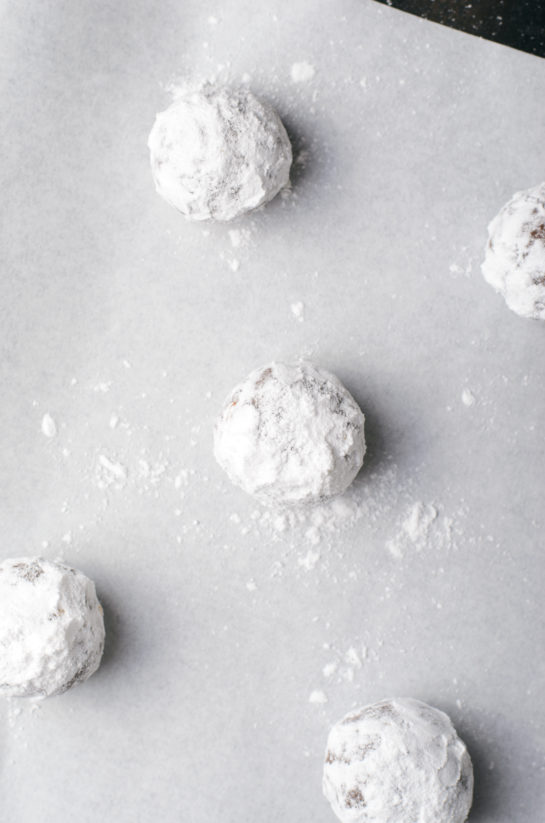 After rolling the cookies in powdered sugar for the chocolate hazelnut crinkle cookies recipe