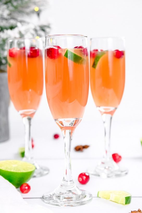 This is a super festive Holiday Mimosas recipe for whether you're hosting a holiday brunch or an elegant holiday party that will brighten everyone's day!
